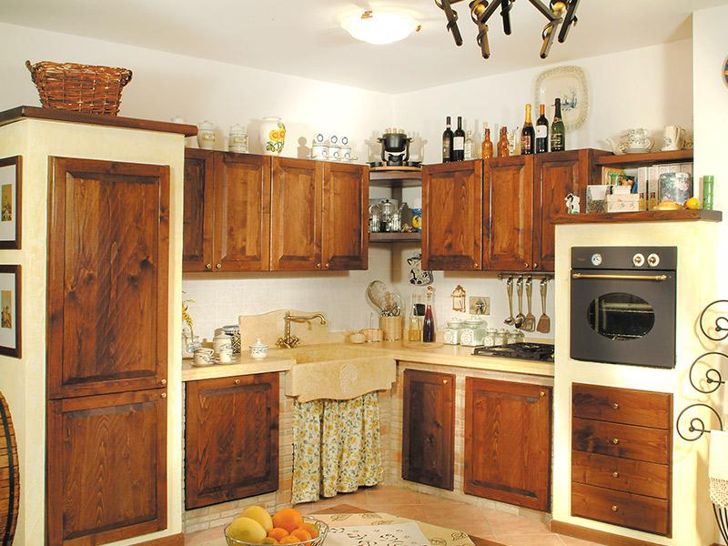 Caminetti carfagna cucine rustiche cucina iris bastia - Cucine rustiche in muratura e legno ...